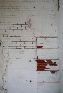 Scheuren in de muur